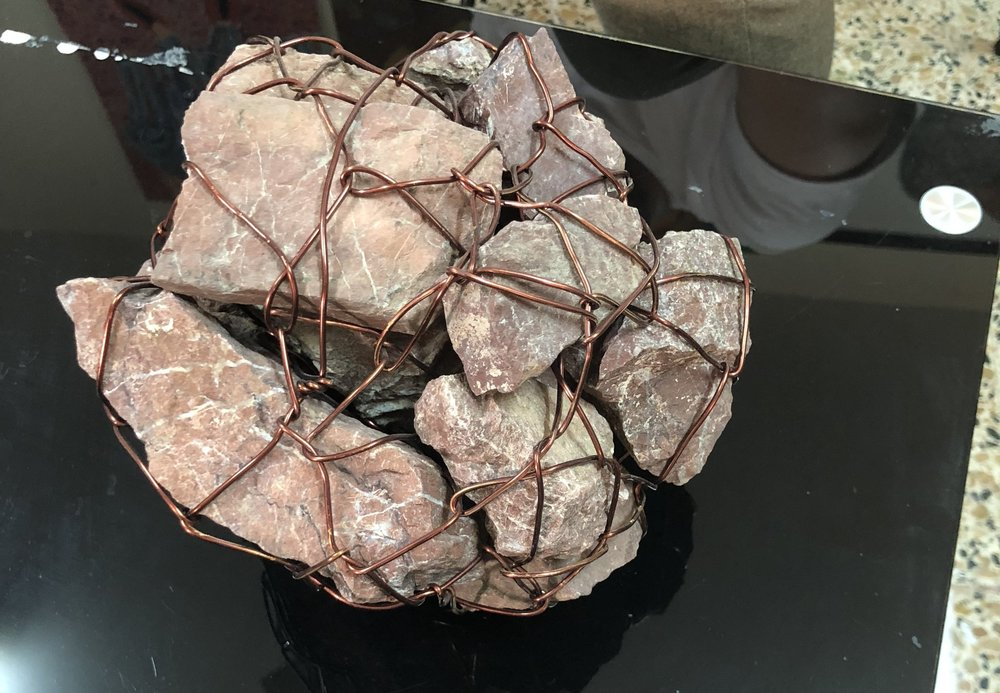 A collection of stones wrapped in copper wire; a typical example of his work and a regular component to his studio. Image taken by Anna Seaman