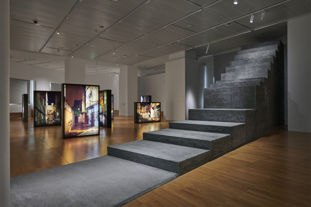 Sandi Hilal and Alessandro Petti.  Common Assembly  (front) and  Refugee Heritage  (back), 2018. Concrete structure, photos and light boxes, variable dimensions. Courtesy of the Artists and NYU Abu Dhabi Art Gallery. Image by John Varghese