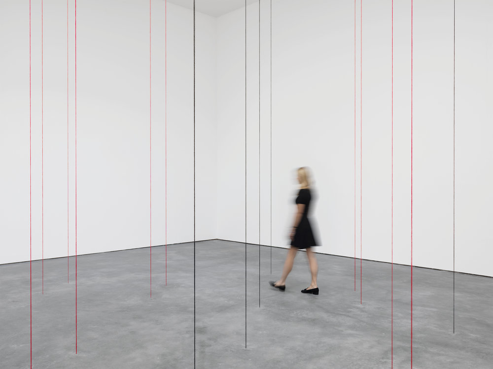 Fred Sandback.Untitled (Sculptural Study, Twenty-two-part Vertical Construction) 1991-2016, black and red acrylic yarn, dimensions variable.The Estate of Fred Sandback. Courtesy David Zwirner