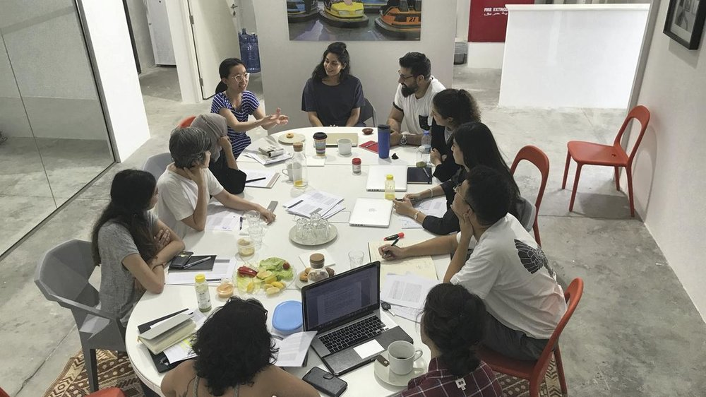 The Campus Art Dubai 5.0 reading group in discussion at the Project Space Art Jameel. Image courtesy of The National.