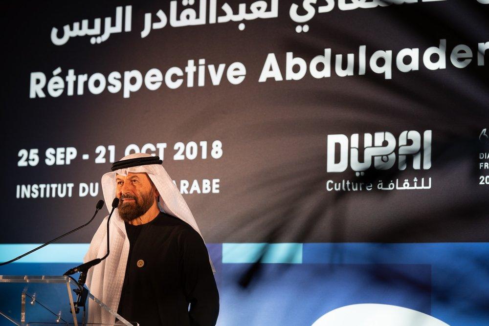 Abdulqader Al Rais addresses audiences at the opening of his retrospective exhibition in Paris. Courtesy Matthew Oliver.