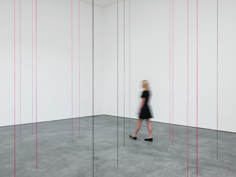 Fred Sandback, Untitled (Sculptural Study, Twenty-two-part Vertical Construction) 1991-2016, black and red acrylic yarn, dimensions variable. The Estate of Fred Sandback, Courtesy David Zwirner.