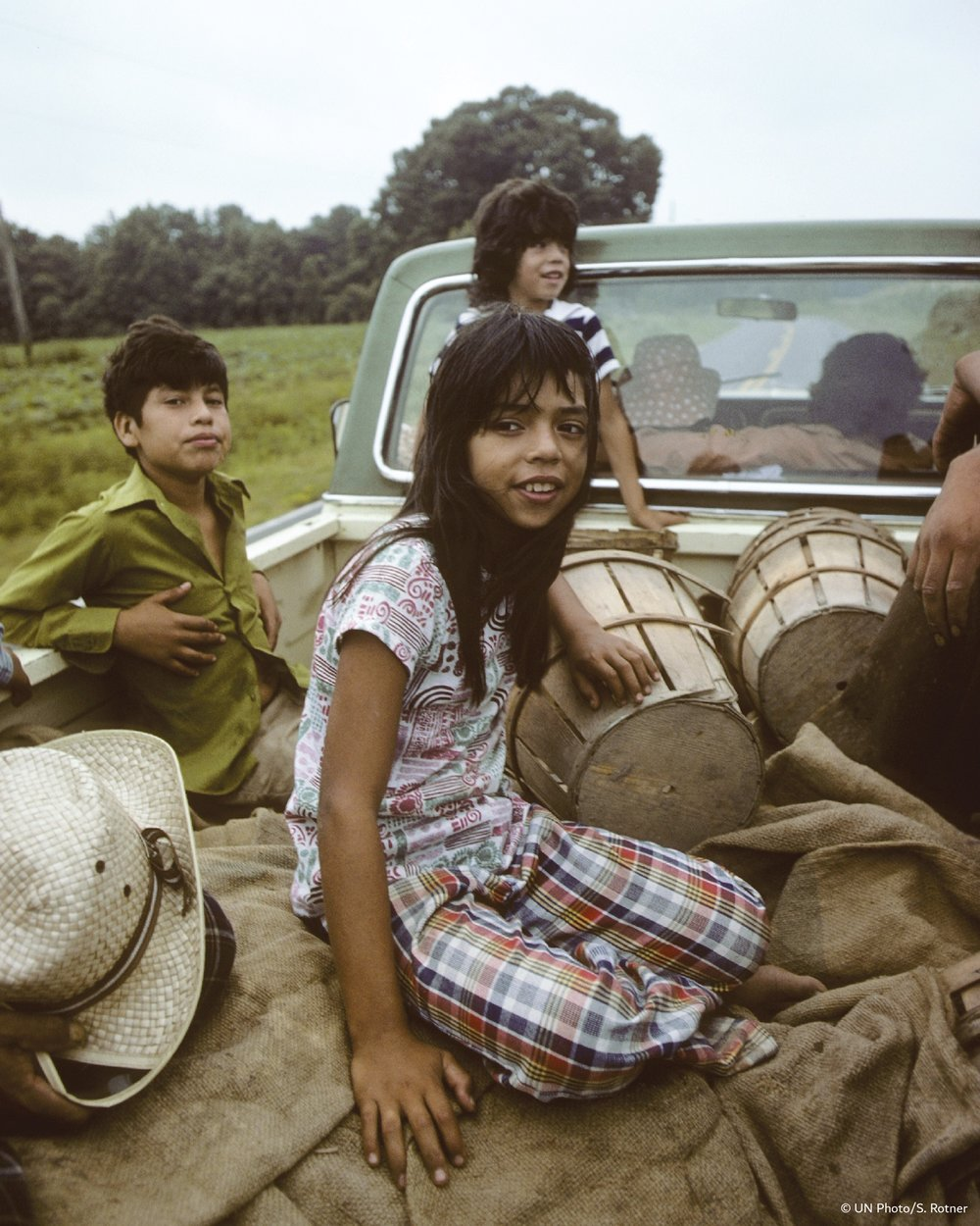 Child migrant workers are driven to fields in North Carolina. Courtesy UN Photo/S.Rotner