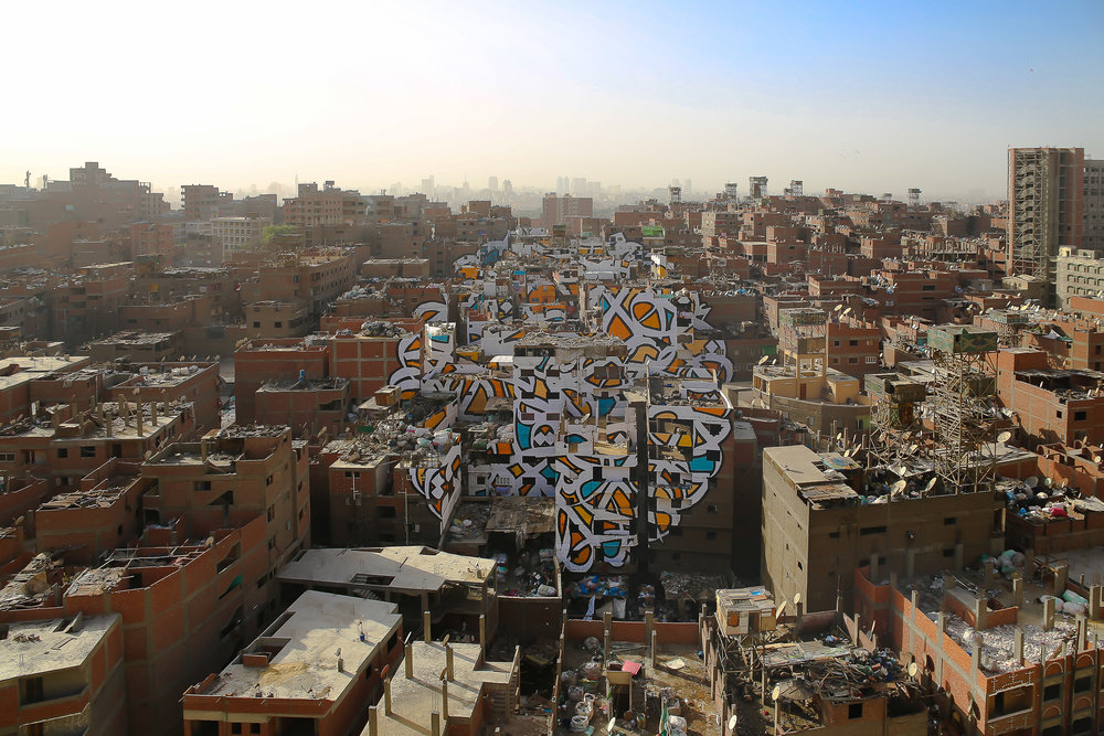 Perception in Cairo's Manshiyat Nasr district was an anamorphic mural painted over 50 buildings and visible from only one viewpoint. Courtesy eL Seed