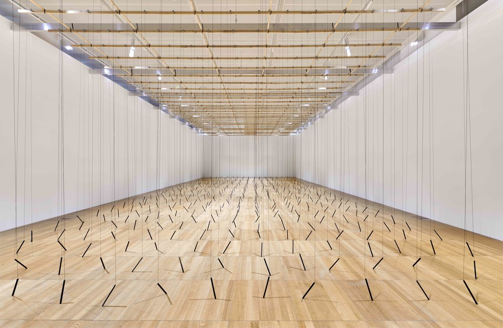 510 Prepared DC-Motors, 2142 m Rope, Wooden Sticks 20 cm - Zimoun's new commission at the NYU Abu Dhabi Art Gallery. Photography John Varghese. Courtesy NYU Abu Dhabi Art Gallery.