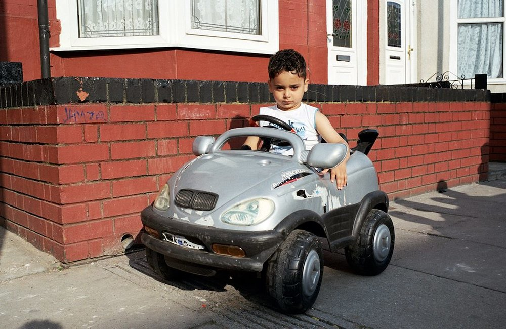 Boy-with-BMW-toy-car-Mahtab-Hussain-You-Get-Me-1024x666.jpg