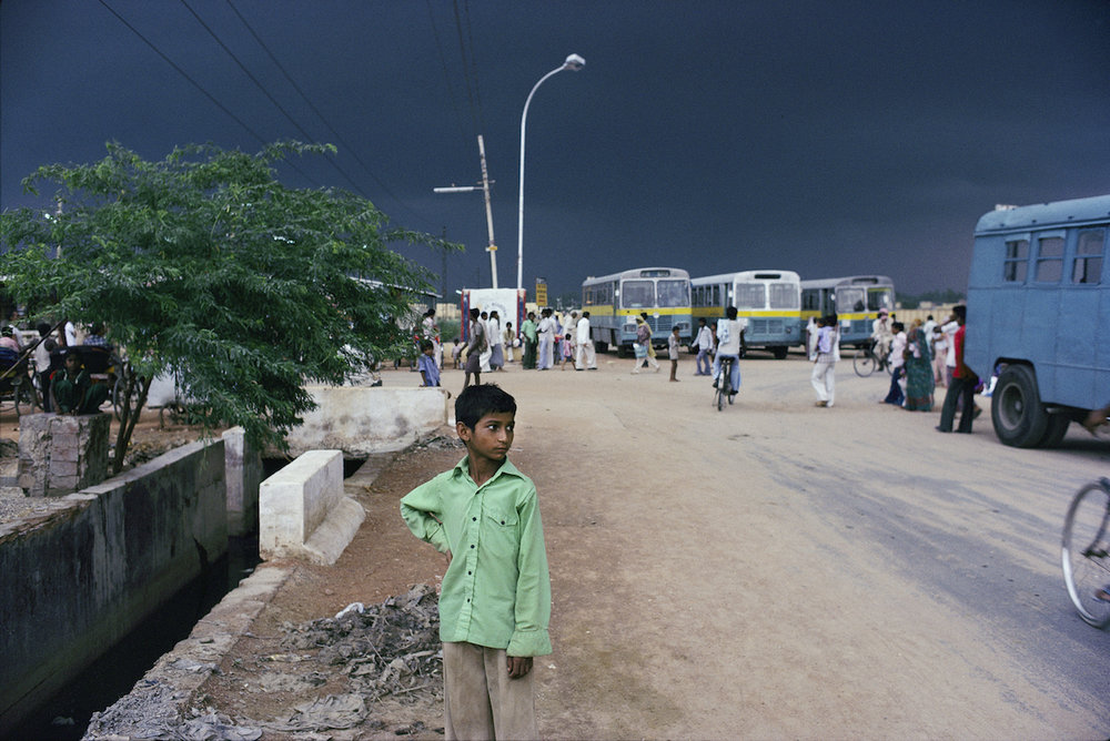 Boy at Bus Stop, New Delhi