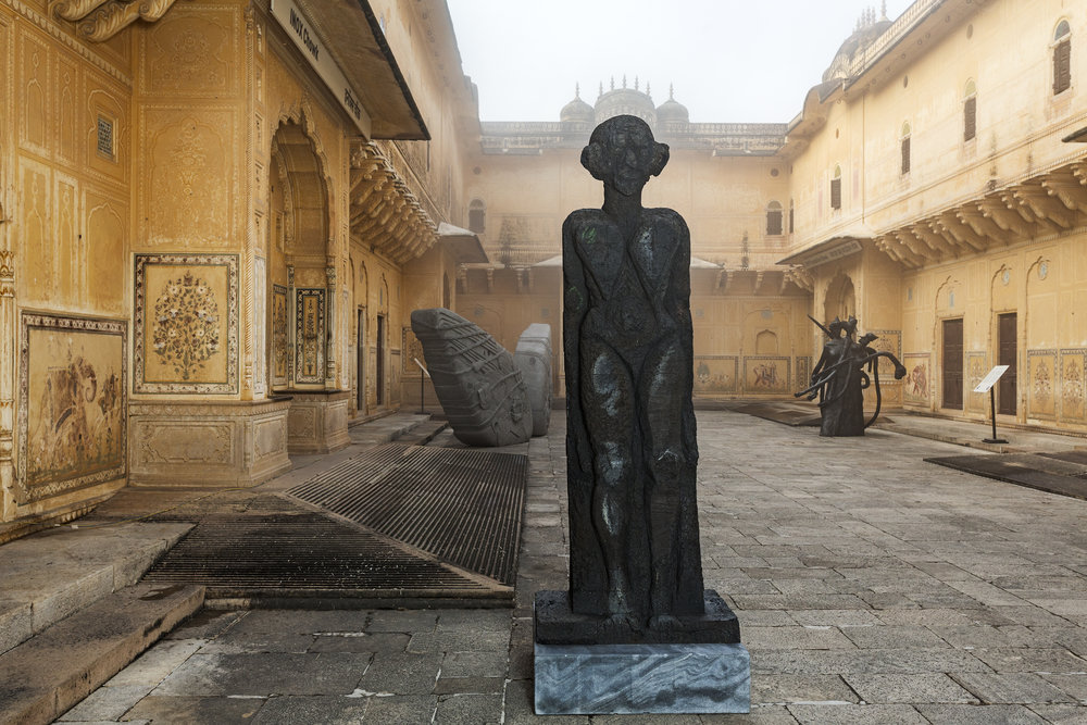 The courtyards of the palace are now filled with sculptures.   Foreground: 'God of Some Things' by New York-based artist Huma Bhabha. Background, left: 'Arrested Image of a Dream' by visual art duo Thukral & Tagra. Background, right: 'Choleric, phlegmatic, melancholy, sanguine' by London-born, Delhi-based Bharti Kher.