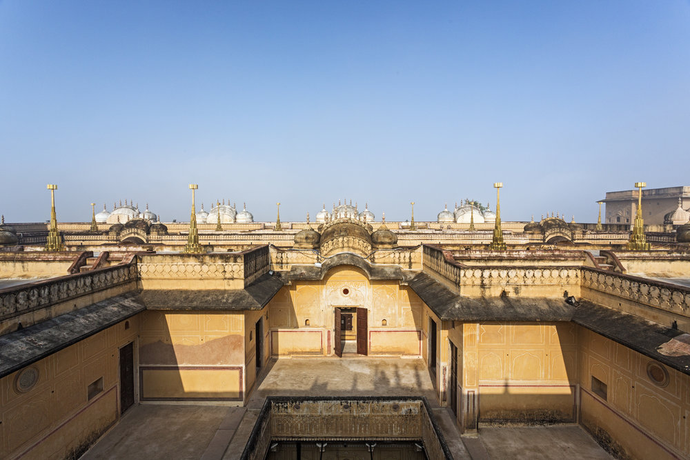Terrace view of the Madhavendra Palace. Vikram Goyal's brass sculpture series 'The Hundred Petal Lotus' sits on the rooftops.