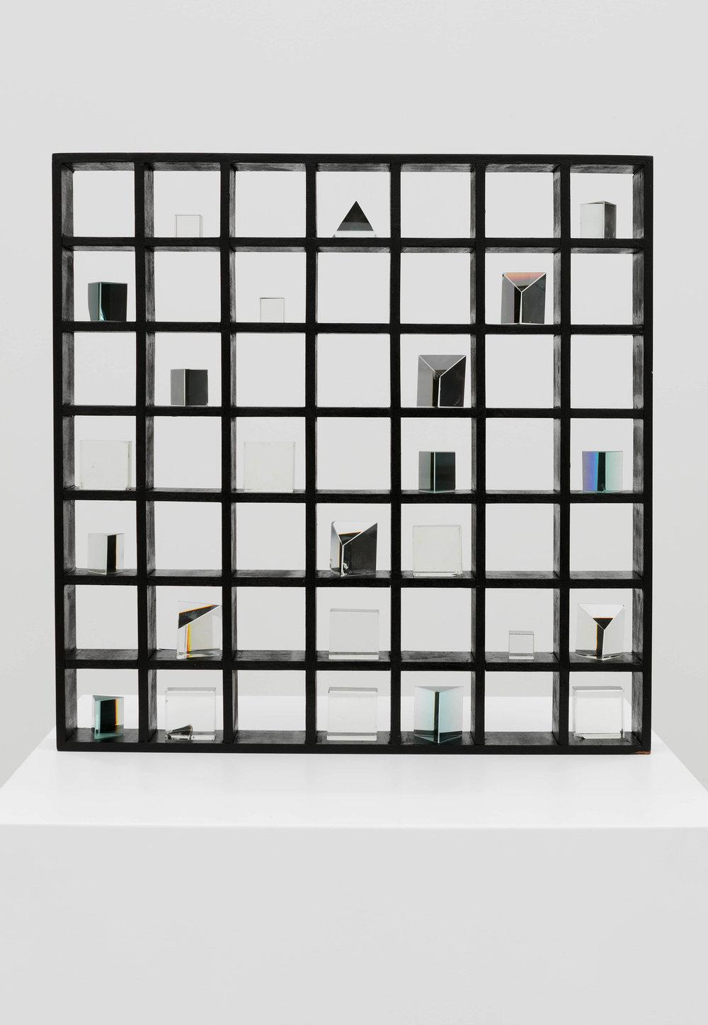 Untitled, wooden grid shelf with prisms 62 x 62 x .6cm, 1983. Courtesy of Nurjahan Akhlaq. Photography Asif Khan & Richard Seck.