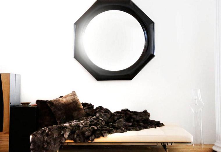 The-Apartment-Soho-white-black-loft-vignette-settee-fur-black-octagonal-mirror-via-Harpers-Bazaar-photo-by-Kelly-Stuart.jpg