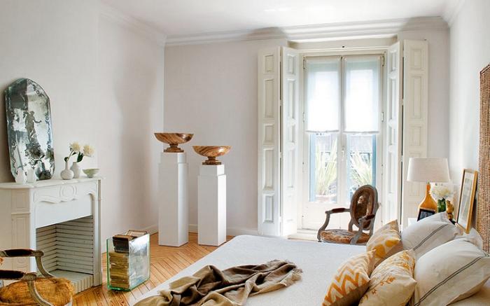 European-elegance-livable-luxury-by-Luis-Puerta-bedroom-rattan-headboard-fireplace-cowhide-Louis-chairs1.jpg