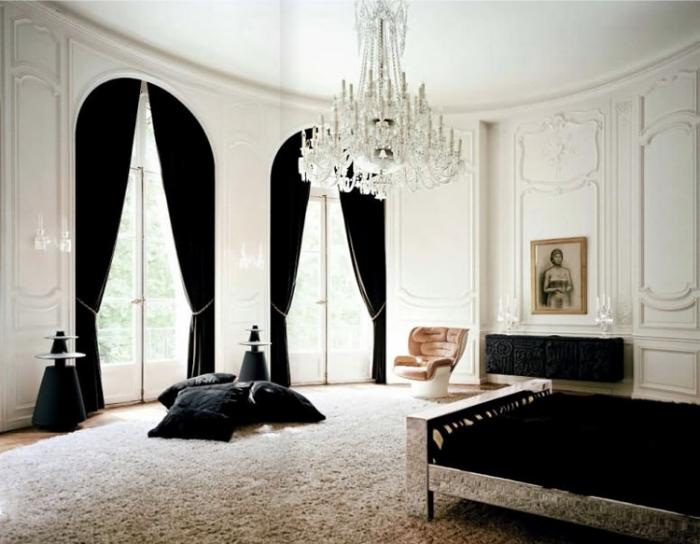 Lenny-Kravitz-Paris-apt-bedroom-black-white-fur-glam-chandelier-1970s-chair1.jpg