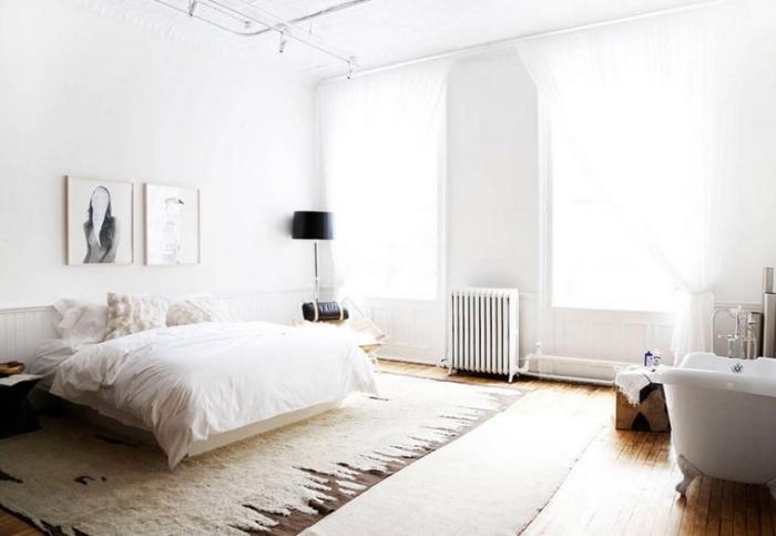 The-Apartment-Soho-white-black-loft-bedroom-bathtub-fur-via-Harpers-Bazaar-photo-by-Kelly-Stuart1.jpg