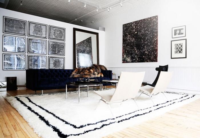 The-Apartment-Soho-white-black-loft-lounge-area-rug-art-fur-via-Harpers-Bazaar-photo-by-Kelly-Stuart.jpg