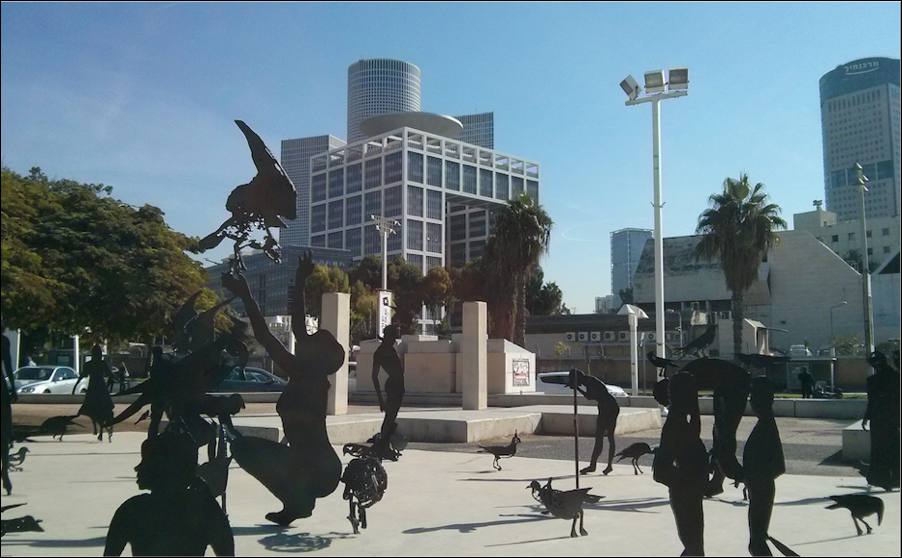 The Kirya. The Israeli military headquarters in central Tel Aviv is home to the International Law Department of the Military Advocate General. It is also one of the key command and control centres used to plan and execute targeting operations. The playful statues in the foreground and the sunny streets belie the violence that is planned and unleashed from military locations like the Kirya. Photo by author.