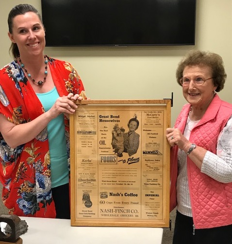 Daniel Feist and Darlene Mathers (Pilot Member) hold an old newspaper that mentions Darlene's father in connection with the oil industry.