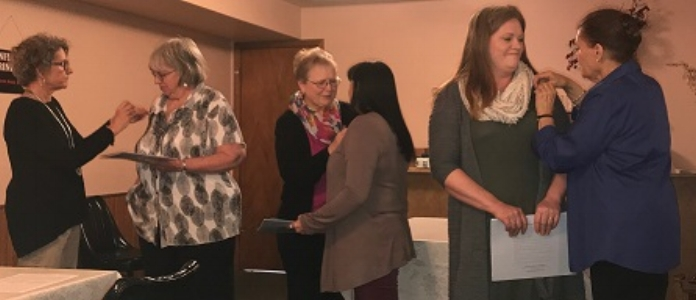 New member pins were presented by Sally O'Connor to Billie Bonomo, by Joyce Fry to Dee Krier and to Nicci Henderson by Renee Johnson.