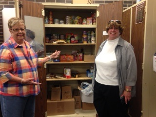 Judy Fox (Projects coordinator) & Rhonda Knudson (President) show the Food Pantry.
