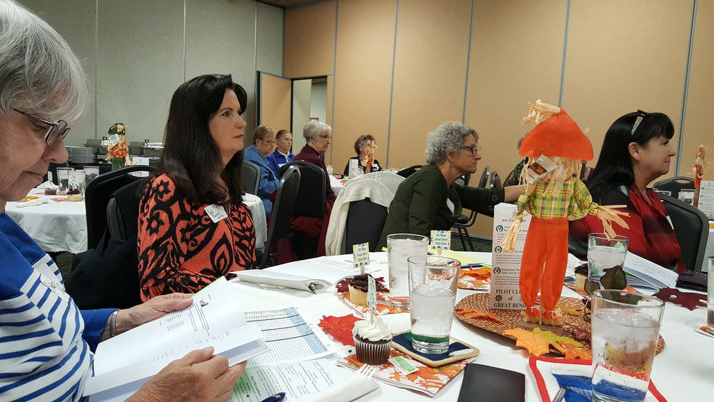 Members listening to the skit presented at Share Pilot about how Pilot Club was started. The Membership Division members decorated the tables with Halloween & Fall items, and provided cupcakes for desert. Door prizes were crafted by Billie Bonomo for some lucky Pilot members.