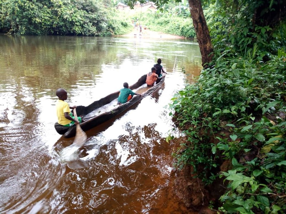 School children who were lucky enough to use the boat shared by the community to cross the river to attend school.