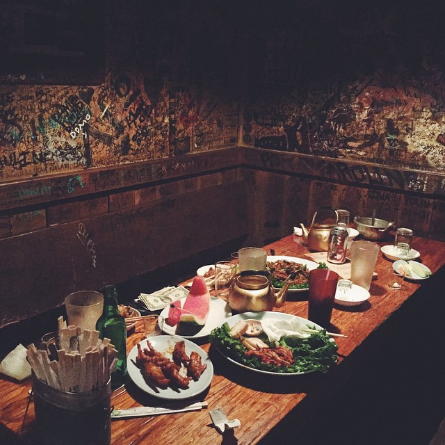 Last night, #feedyourboss feasted at one of our favorite places in the city. We got all liquored up on house-made green tea soju, we ate spicy chicken feet and steamed pork belly, we listened to Korean pop music burned onto CD's, and then, we scribbled onto the walls. @dan_sung_sa_la is one helluva soul bar.