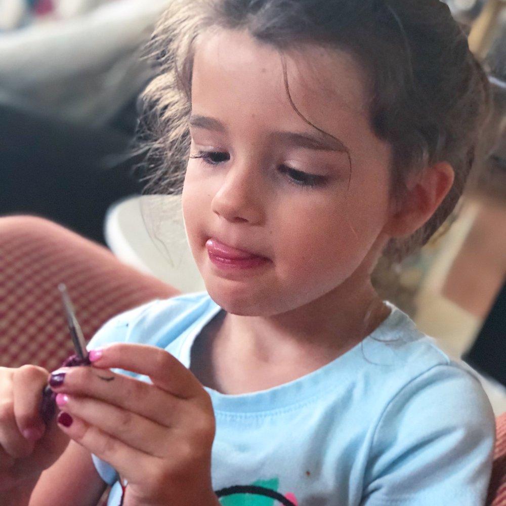 little girl knitting