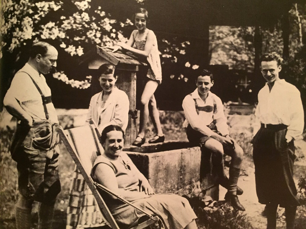 My Grandmother Annelise (standing on well) and her Family in their backyard, Munich ca. 1928