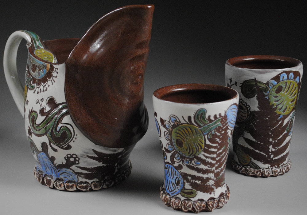 """Folk Set, Pitcher and Cups - Earthenware with Underglaze, Plant Print and carved Pattern, Pitcher 6""""x9""""x9"""", Cups 6""""x3.5""""x3.5"""""""