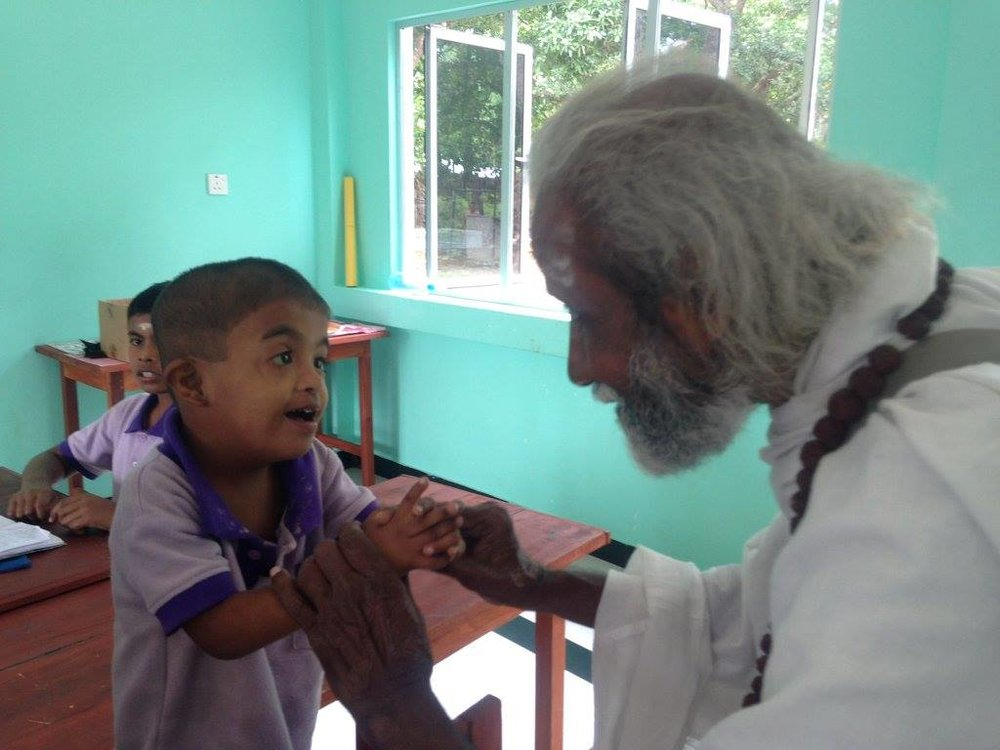 Our beloved Mr. Kaliyugavarathan (Swamiji) meeting one of the children with special needs.