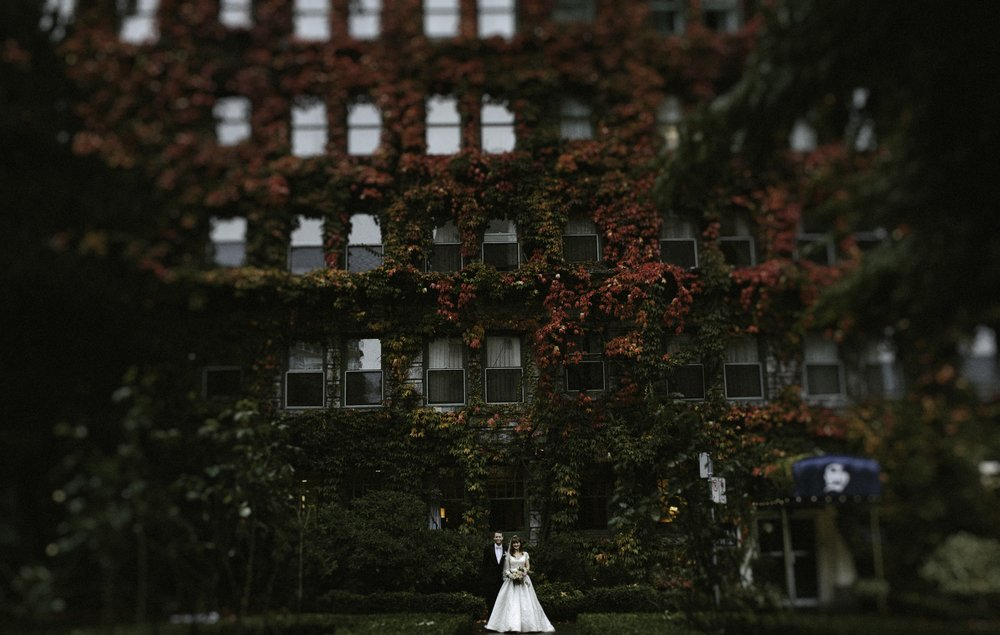 Vancouver Wedding Photographer - Bride And Groom In Front Of An Ivy-Covered Building