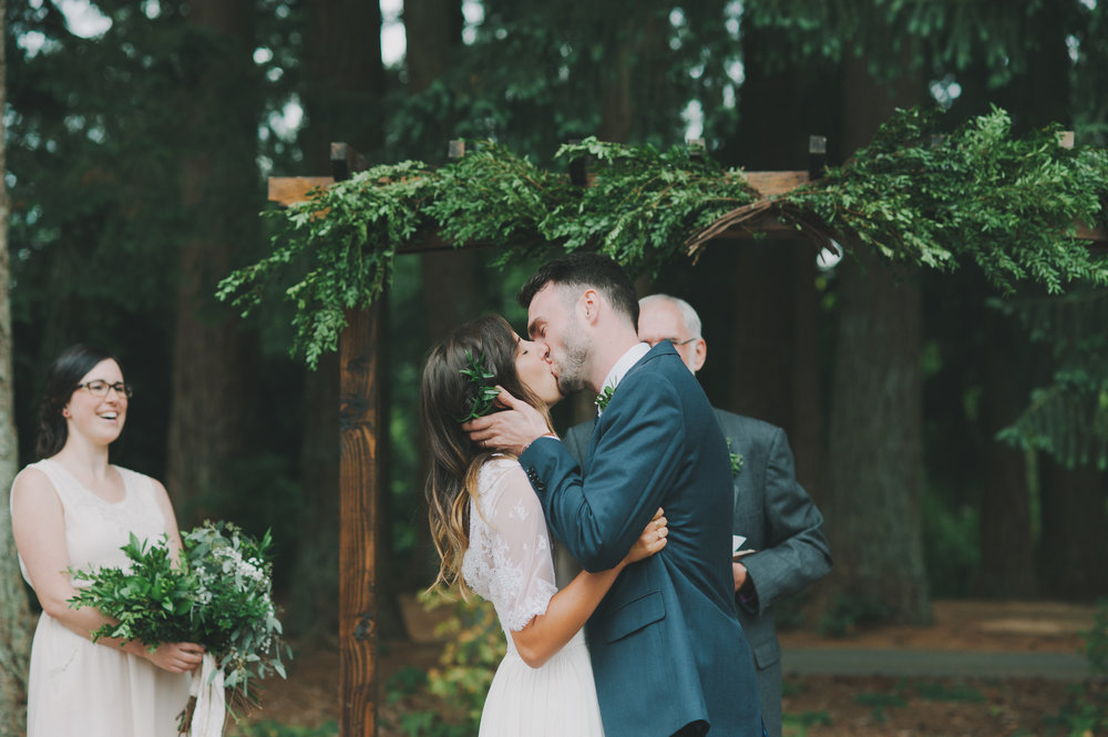 Vancouver Wedding Photographer - Bride And Groom Kissing At Their Wedding Ceremony In The Forest
