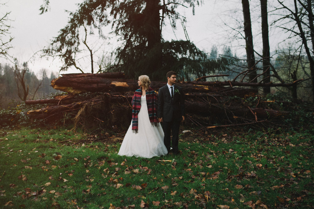 Vancouver Wedding Photographer - Bride And Groom Standing in Front Of Logs