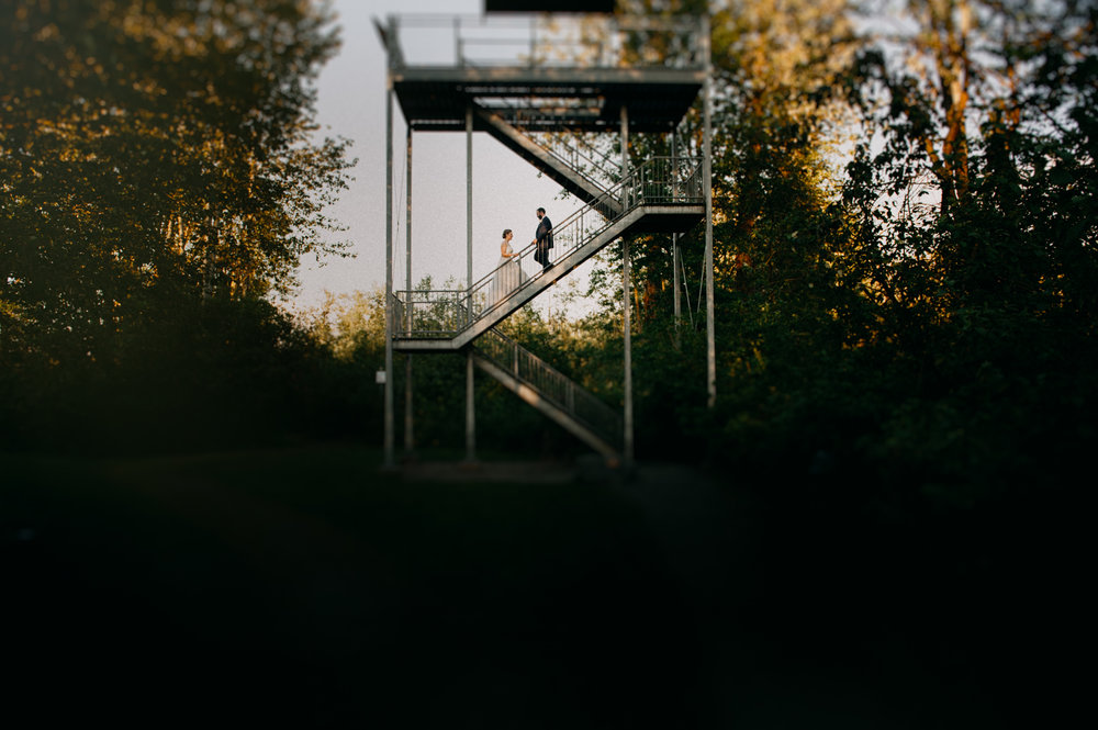 Vancouver Wedding Photographer - Bride And Groom High Up On A Structure In The Forest
