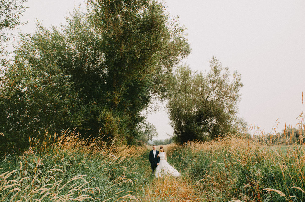 Vancouver Wedding Photographer - Bride And Groom In an Open Field With Trees