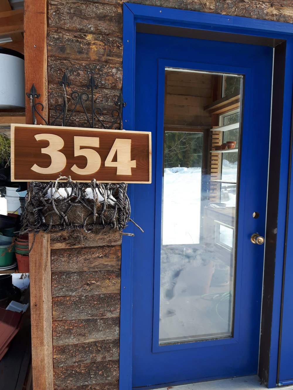 "House number, reverse engraved on pine.   Approx 10"" x 2'.  $135"