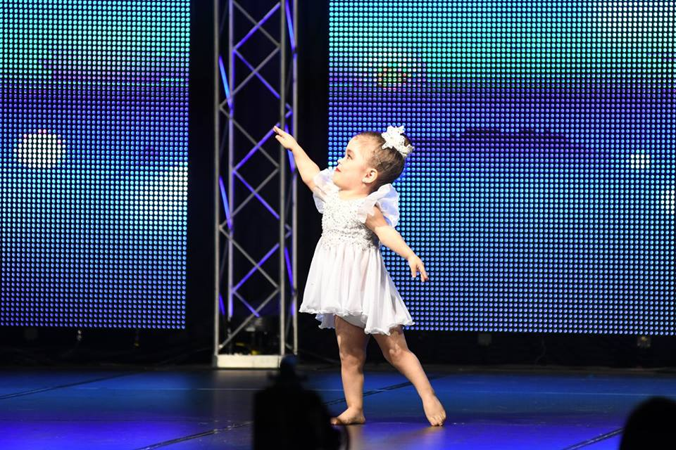 Ava is a little person (achondroplasia). She is one of our competitive dancers and competes solos, duos, trios and dances with our mini, junior and senior teams.