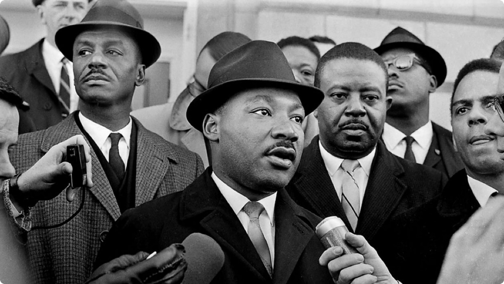 """Martin Luther King Jr. (January 15, 1929 – April 4, 1968) was an American  Baptist minister and activist who became the most visible spokesperson and leader in the  civil rights movement . He is best known for his role in the advancement of  civil rights using the tactics of  nonviolence and  civil disobedience based on his  Christian beliefs and inspired by the nonviolent activism of  Mahatma Gandhi .  King became a civil rights activist early in his career. He led the 1955  Montgomery bus boycott and helped found the  Southern Christian Leadership Conference (SCLC) in 1957, serving as its first president. With the SCLC, he led an unsuccessful  1962 struggle against segregation in  Albany, Georgia , and helped organize the nonviolent 1963 protests in  Birmingham, Alabama . He also helped to organize the 1963  March on Washington , where he delivered his famous """" I Have a Dream """" speech.  On October 14, 1964, King received the  Nobel Peace Prize for combating  racial inequality through  nonviolent resistance . In 1965, he helped to organize the  Selma to Montgomery marches , and the following year he and the SCLC took the movement north to  Chicago to work on segregated housing. In the final years of his life, he expanded his focus to include opposition towards  poverty and the  Vietnam War , alienating many of his  liberal allies with a 1967 speech titled """" Beyond Vietnam """".  In 1968, King was planning a national occupation of Washington, D.C., to be called the  Poor People's Campaign , when he was  assassinated by  James Earl Ray on April 4 in  Memphis, Tennessee . King's death was followed by  riots in many U.S. cities . Ray, who fled the country, was arrested two months later at  London Heathrow Airport . Ray was sentenced to 99 years in prison for King's murder, and died in 1998 from  hepatitis while serving his sentence.  King was posthumously awarded the  Presidential Medal of Freedom and the  Congressional Gold Medal . Martin Luther King Jr. Day was establis"""
