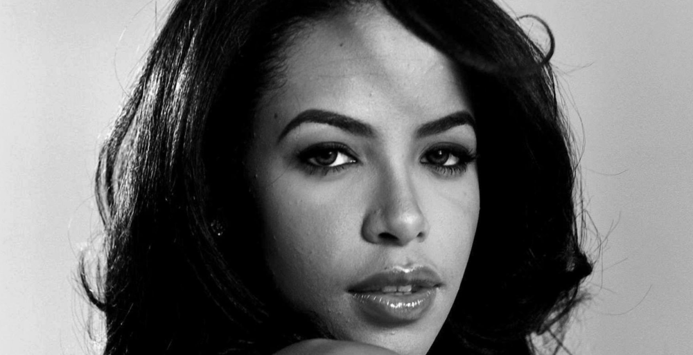 """Aaliyah Dana Haughton  (January 16, 1979 – August 25, 2001) was an American singer, actress, and model.  Born in  Brooklyn ,  New York , and raised in  Detroit , Michigan, Aaliyah first gained recognition at the age of 10, when she appeared on the television show   Star Search   and performed in concert alongside  Gladys Knight . At age 12, Aaliyah signed with  Jive Records  and her uncle  Barry Hankerson 's  Blackground Records . Hankerson introduced her to  R. Kelly , who became her mentor, as well as lead songwriter and producer of her debut album,   Age Ain't Nothing but a Number  . The album sold three million copies in the United States and was certified double platinum by the  Recording Industry Association of America  (RIAA). After facing  allegations of an illegal marriage with Kelly , Aaliyah ended her contract with Jive and signed with  Atlantic Records .  Aaliyah worked with record producers  Timbaland  and  Missy Elliott  for her second album,   One in a Million  , which sold 3 million copies in the United States and over eight million copies worldwide. In 2000, Aaliyah appeared in her first film,   Romeo Must Die  . She contributed to the film's soundtrack, which spawned the single """" Try Again """". The song topped the   Billboard  Hot 100  solely on  airplay , making Aaliyah the first artist in   Billboard   history to achieve this goal. """"Try Again"""" also earned Aaliyah a  Grammy Award  nomination for Best Female R&B Vocalist. After completing  Romeo Must Die , Aaliyah filmed her role in   Queen of the Damned  , and released her third and final studio album,   Aaliyah  , in 2001.  On August 25, 2001, Aaliyah and eight others were killed in a plane crash in  the Bahamas  after filming the music video for the single """" Rock the Boat """". Aaliyah's music has continued to achieve commercial success with several posthumous releases, and has sold an estimated 24 to 32 million albums worldwide. She has been credited for helping redefine  contemporary R&B ,  pop  an"""