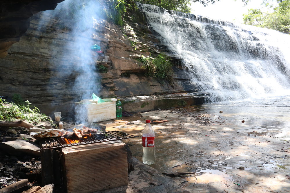 The most Brazilian thing you'll ever see. Churrasco by a waterfall