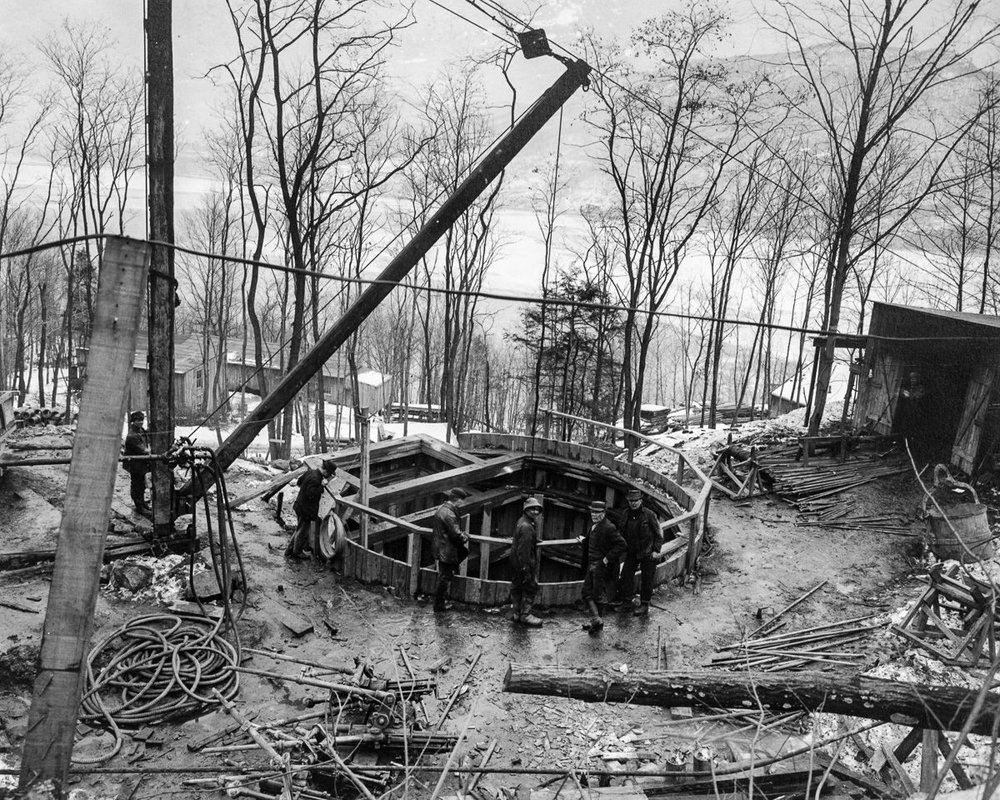 The top of Shaft 7 of the Moodna pressure tunnel, with the Hudson River in the background, New York, 1910.