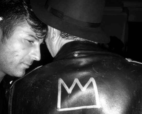 The late Glenn O'Brien wearing a leather jacket signed by Jean-Michel Basquiat with his signature Crown, New York, Date unknown.