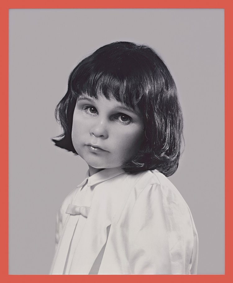 Gillian Wearing's  Self-Portrait at Three Years Old  (2004) confronts the viewer with her adult gaze through the eyeholes of the toddler's mask.