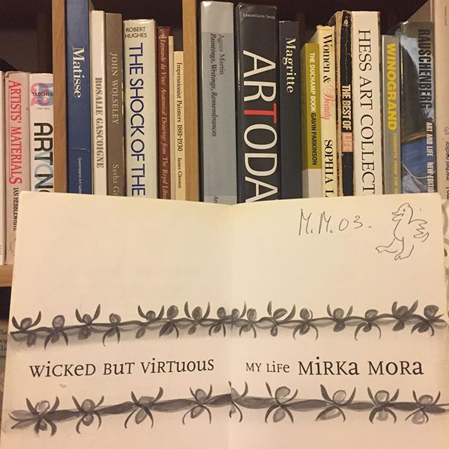 With her bright twinkling eyes and cheeky smile, she ever so generously  signed and drew one of her infamous birds in a copy of her autobiography. I stood before her smitten and startruck at a book signing, before she was whisked away by her agent, smiling back at me like a mischievous angel. #mirkamora 🐦🐤🥀