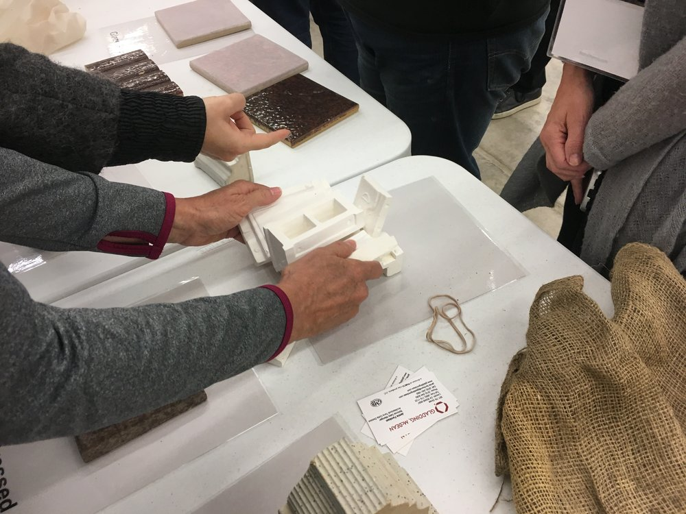 Jammie Farnham from Gladding McBean demonstrating how terra cotta molds are taken apart on a miniature mold.