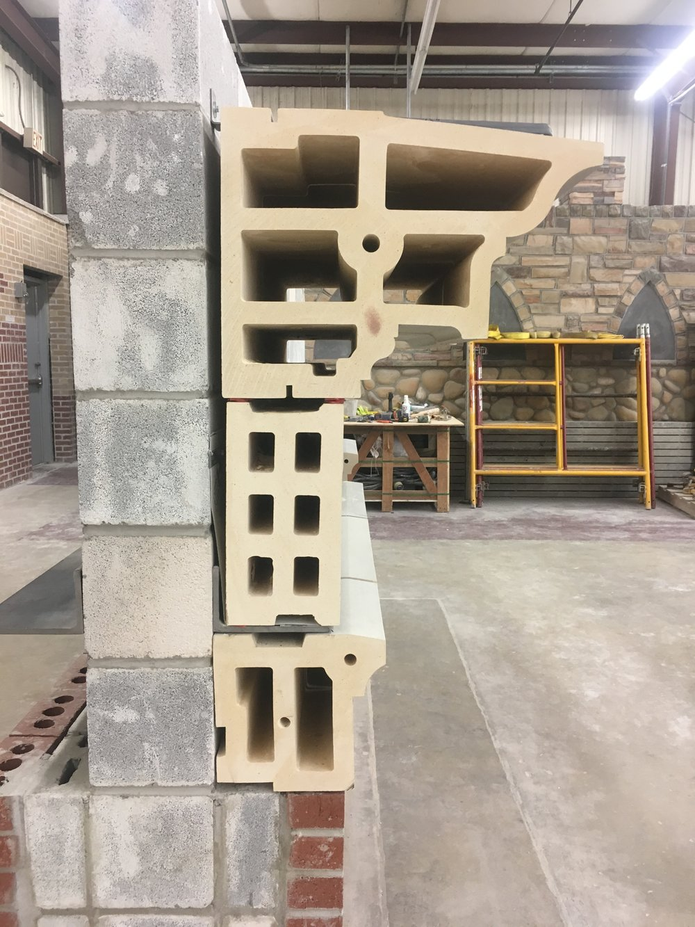 A model cornice assembly constructed from extruded terra cotta blocks.