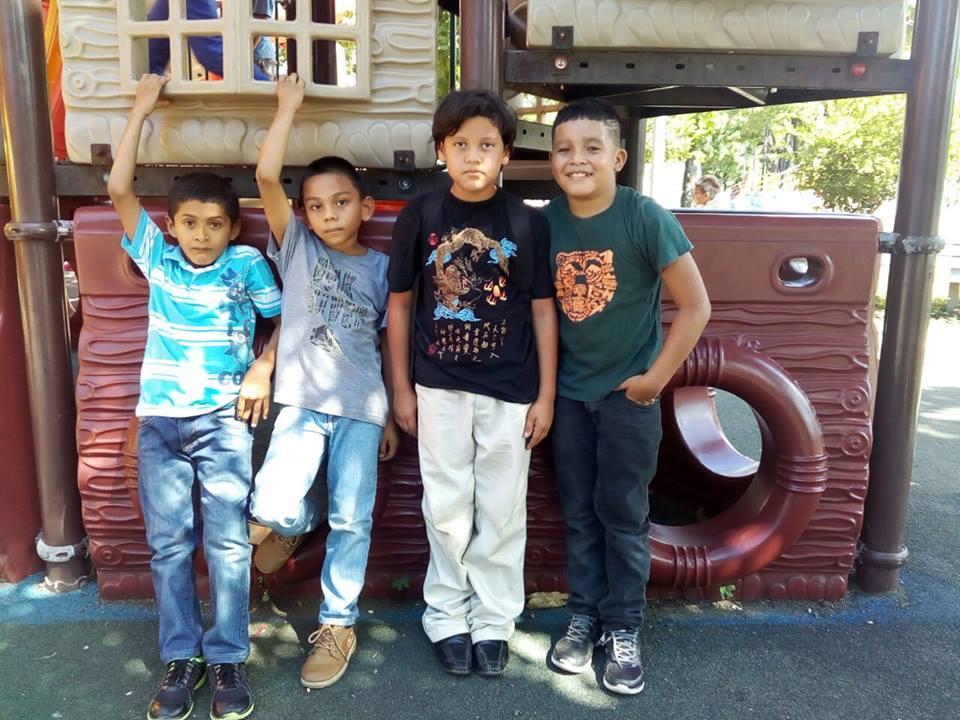 4 boys - 2 holding arms up.jpg