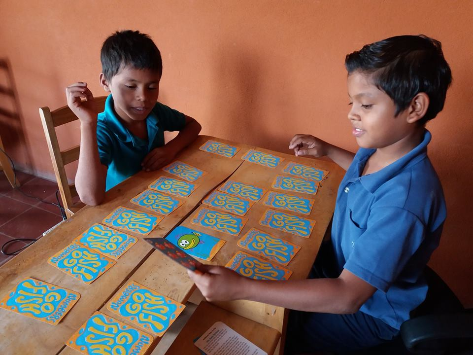 2 boys play go fish card game.jpg