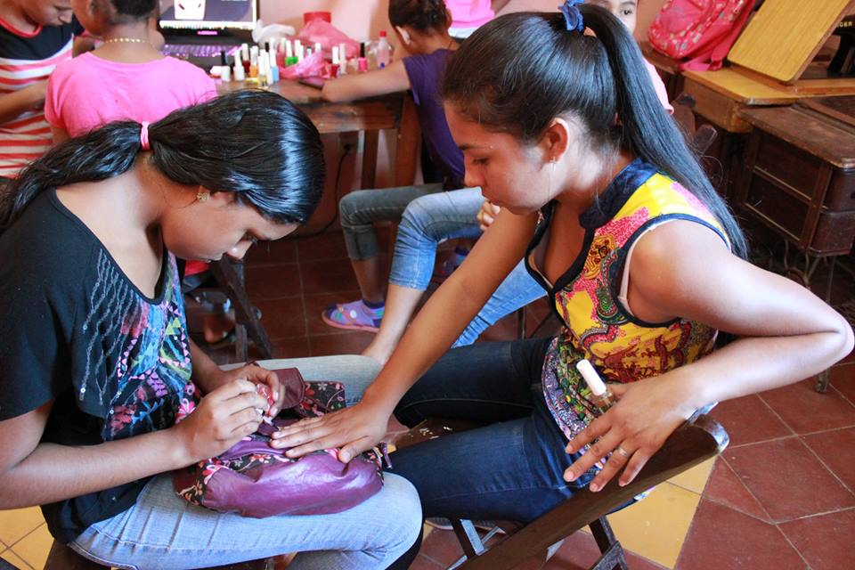 2 girls painting nails.jpg