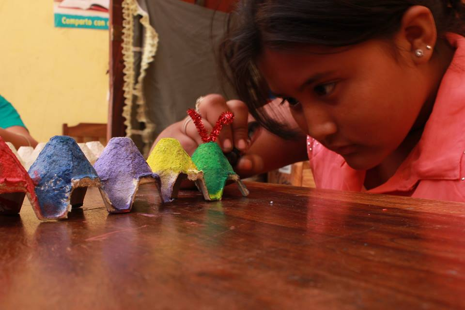 Girl examining craft project.jpg